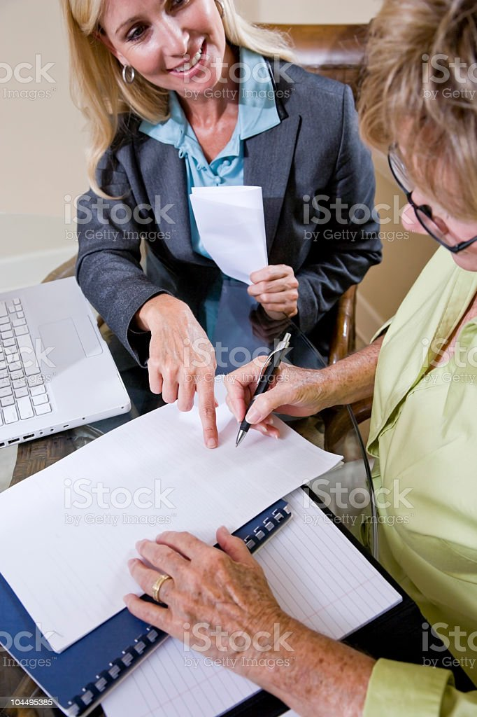 Cropped view of senior woman signing contract royalty-free stock photo