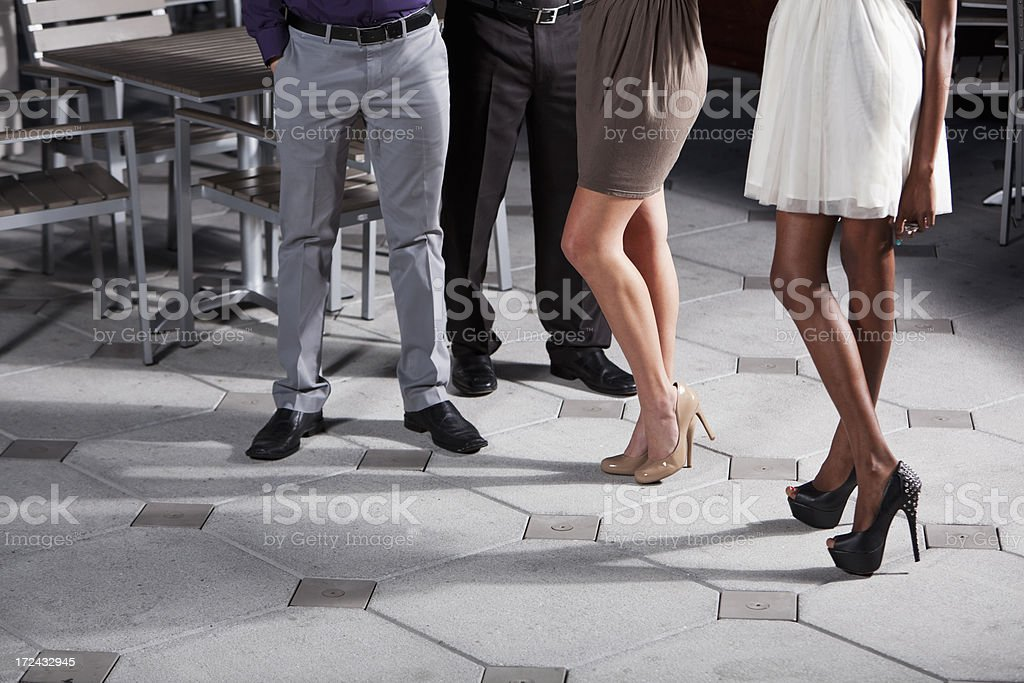 Cropped view of two couples in restaurant. stock photo