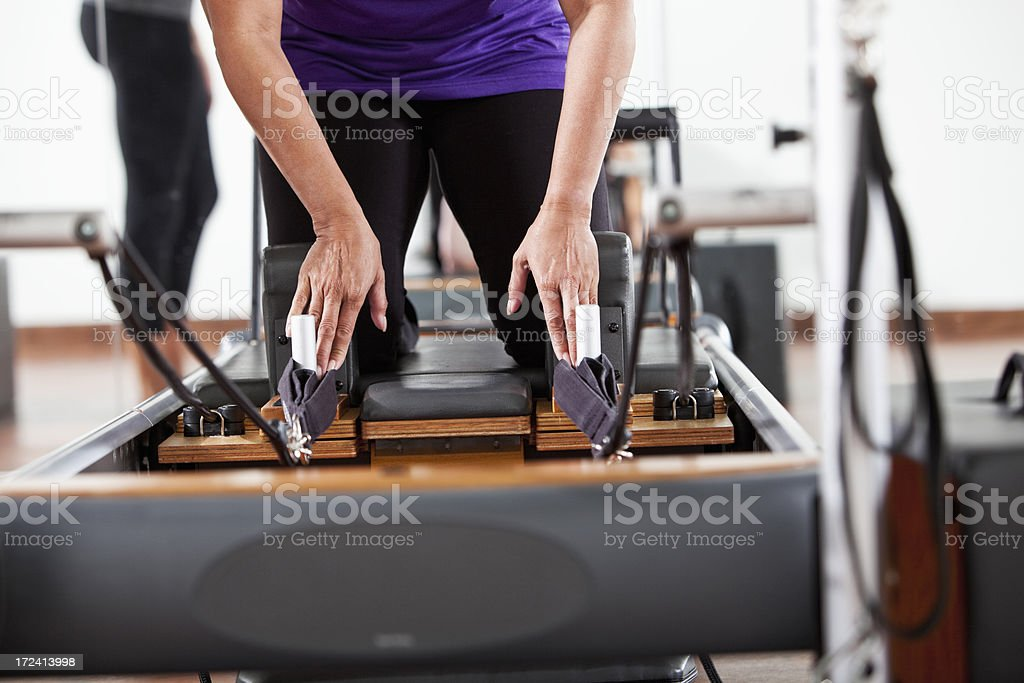 Cropped woman on pilates reformer stock photo