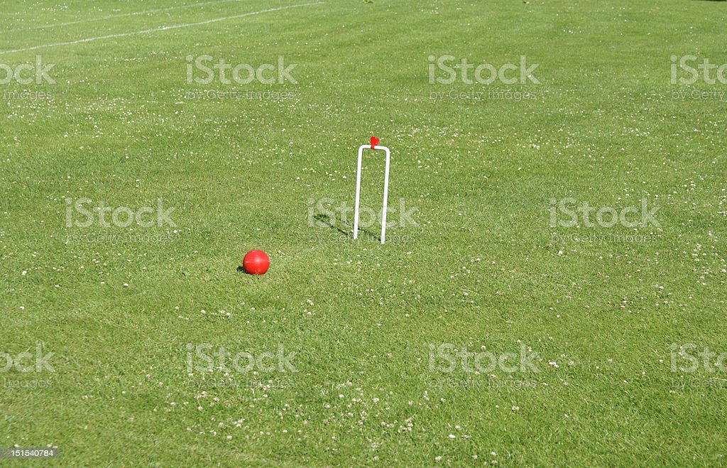 Croquet ball and goal stock photo
