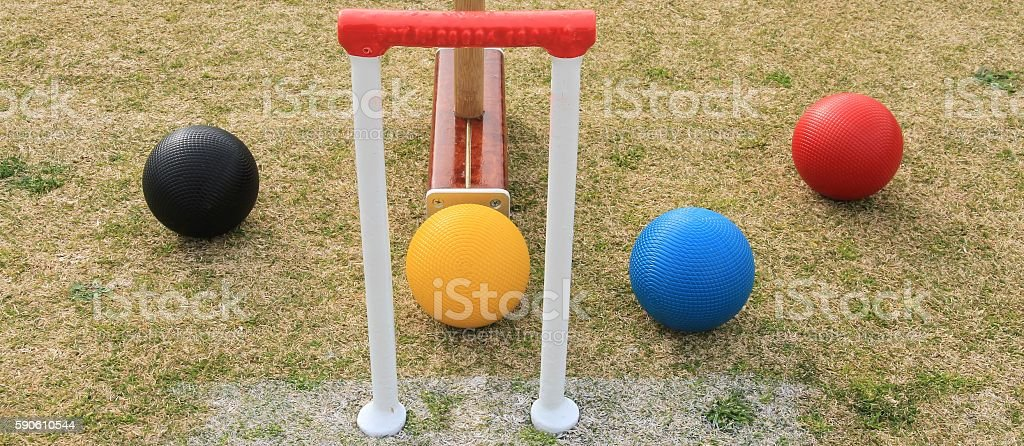 Croquet hoop and balls in widescreen format stock photo