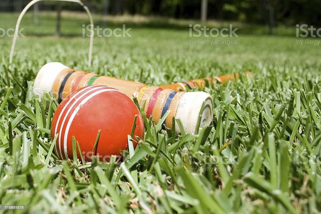 Croquet mallet and ball on grass field. Sports, game. Wicket. stock photo