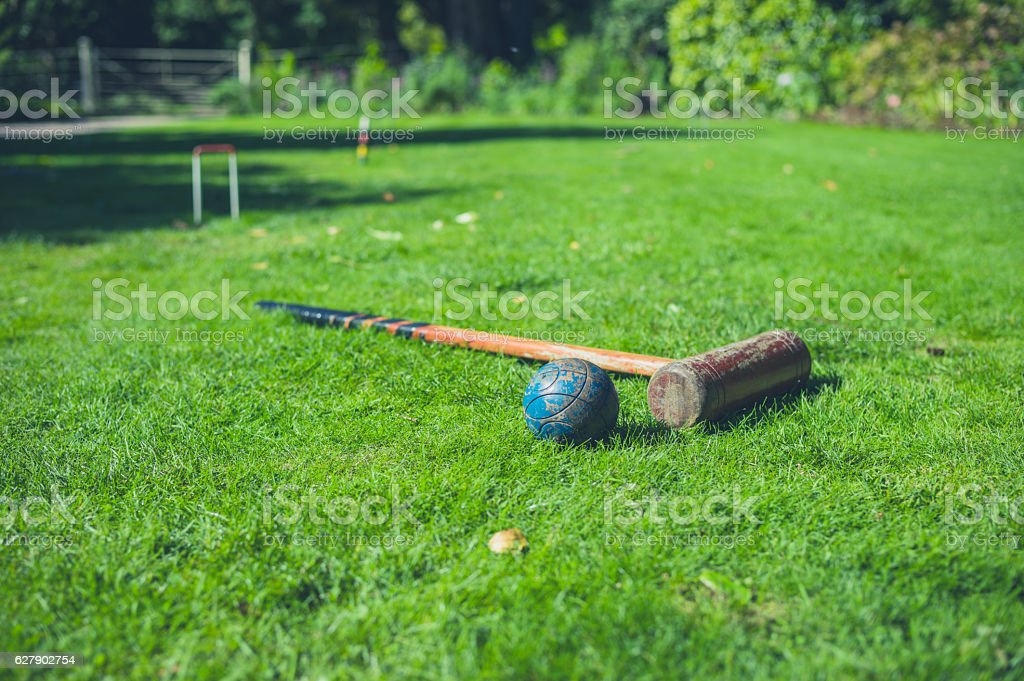 Croquet mallet and ball stock photo