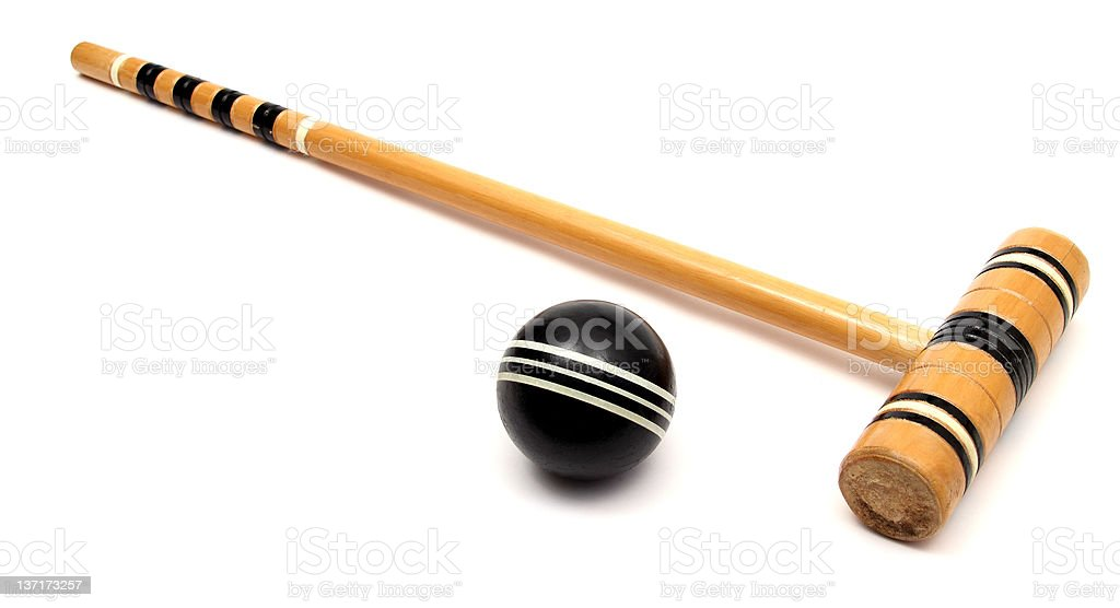 Croquet mallet with a black croquet ball stock photo