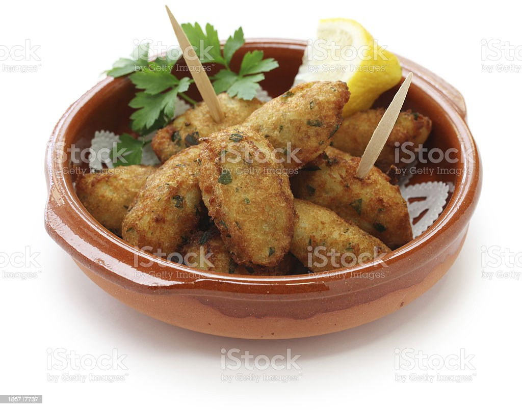 croquettes made of salt cod, potatoes, eggs and parsley. stock photo