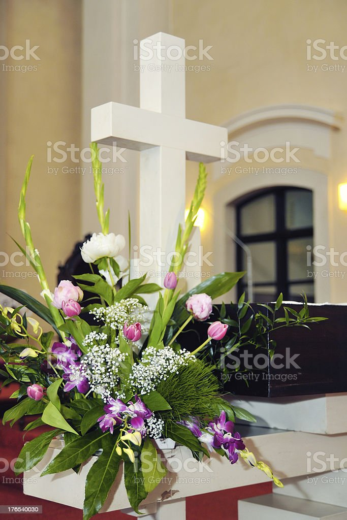 Cross a bouquet on the altar stock photo