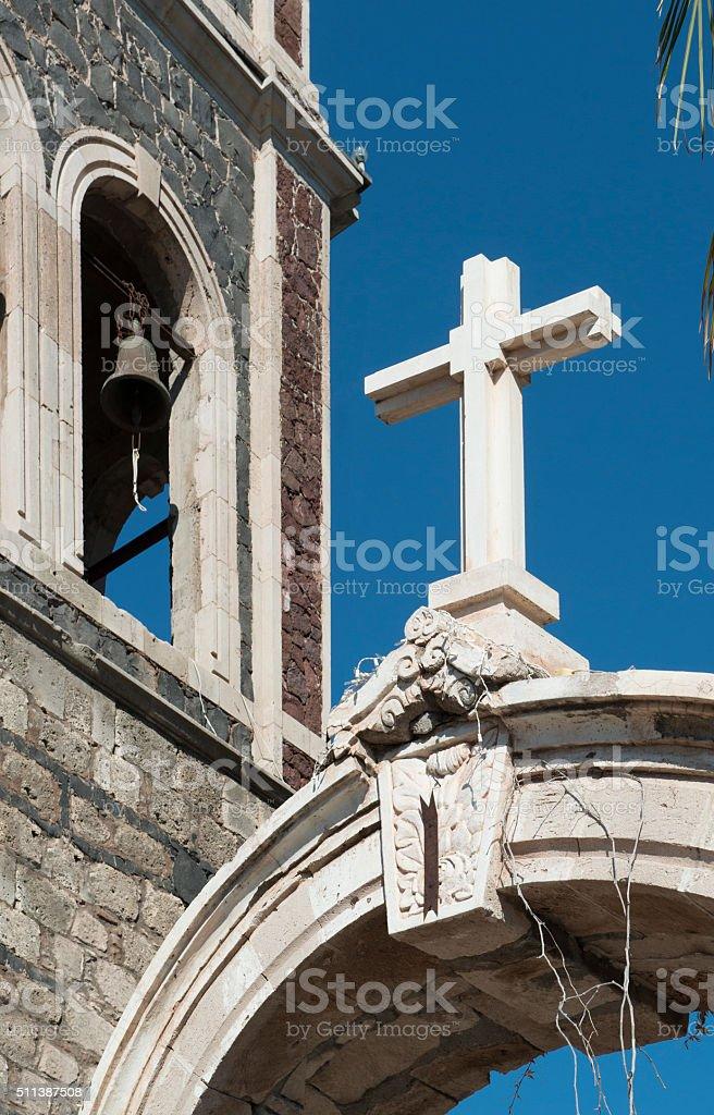 Cross above archway at  Nuestra Senora de Loreto stock photo