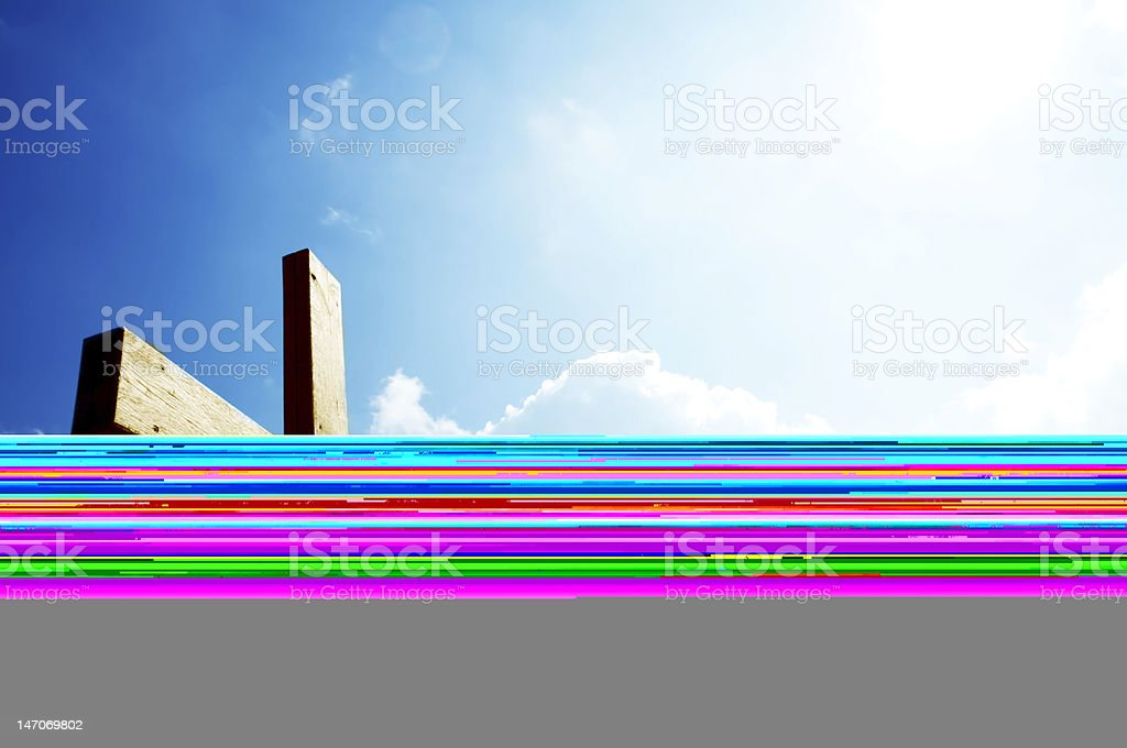 A cross against a bright blue sky stock photo