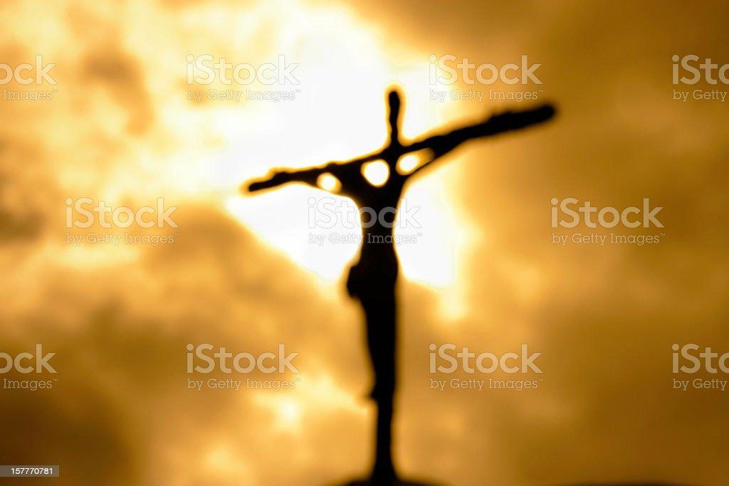 Cross against a dark yet bright sky symbolizing forgiveness royalty-free stock photo