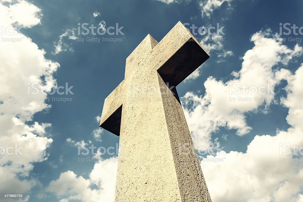 Cross against dramatic sky stock photo