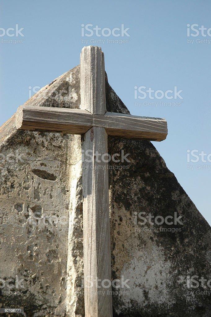 Cross Against Sone stock photo