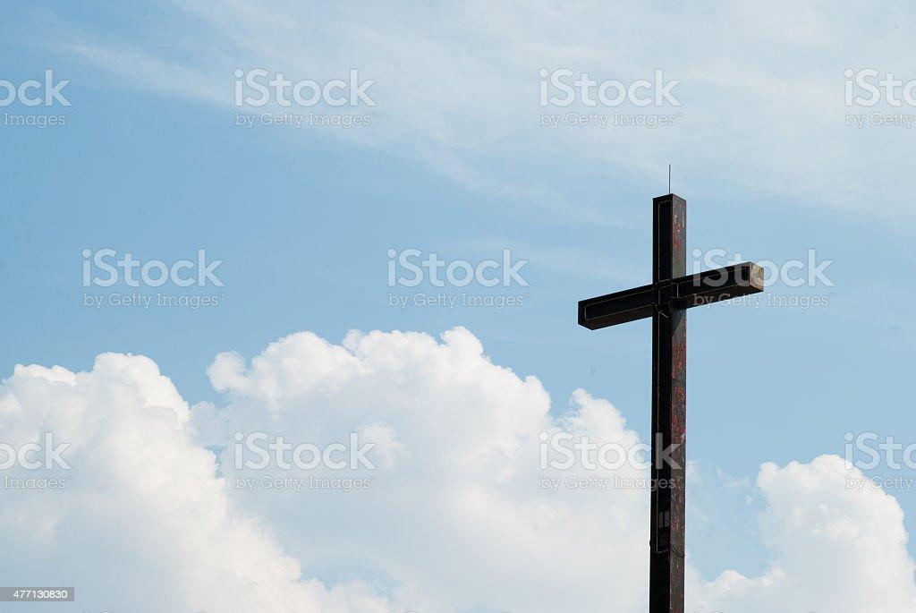 cross against the sky stock photo