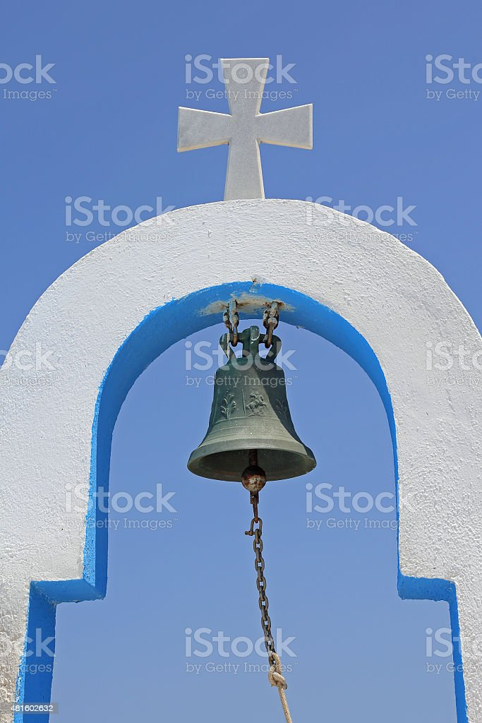 cross and bell of a greek church stock photo