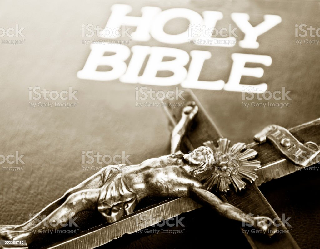 Cross and closed bible stock photo