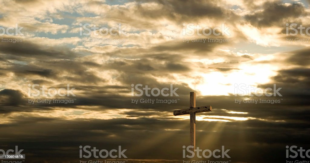 Cross and Dramatic Sky with sun rays and dark clouds stock photo