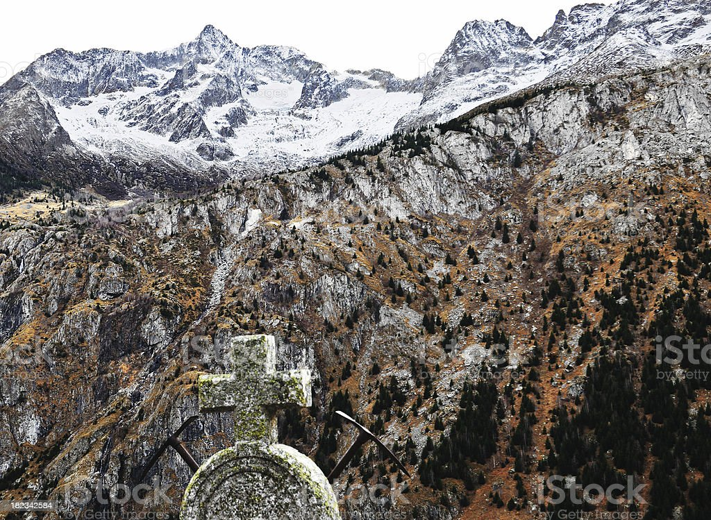 cross and ice picks in the Alps stock photo
