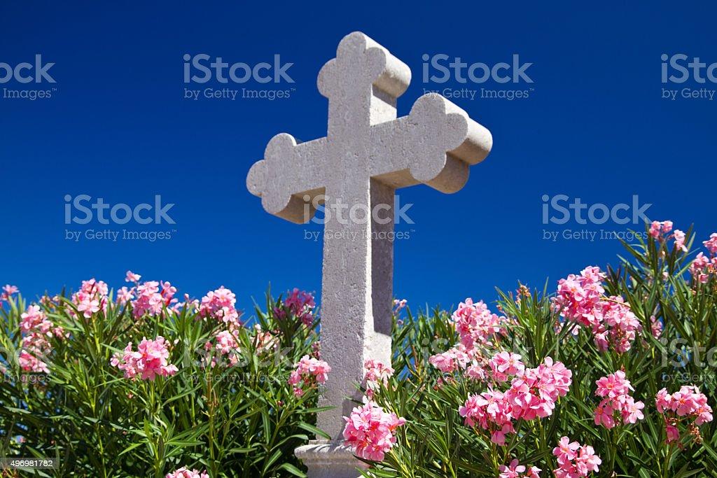 Cross and oleanders stock photo