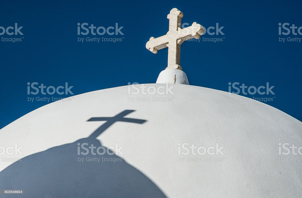 Cross and shadow stock photo