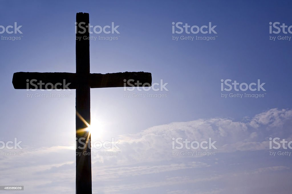 cross and sun stock photo