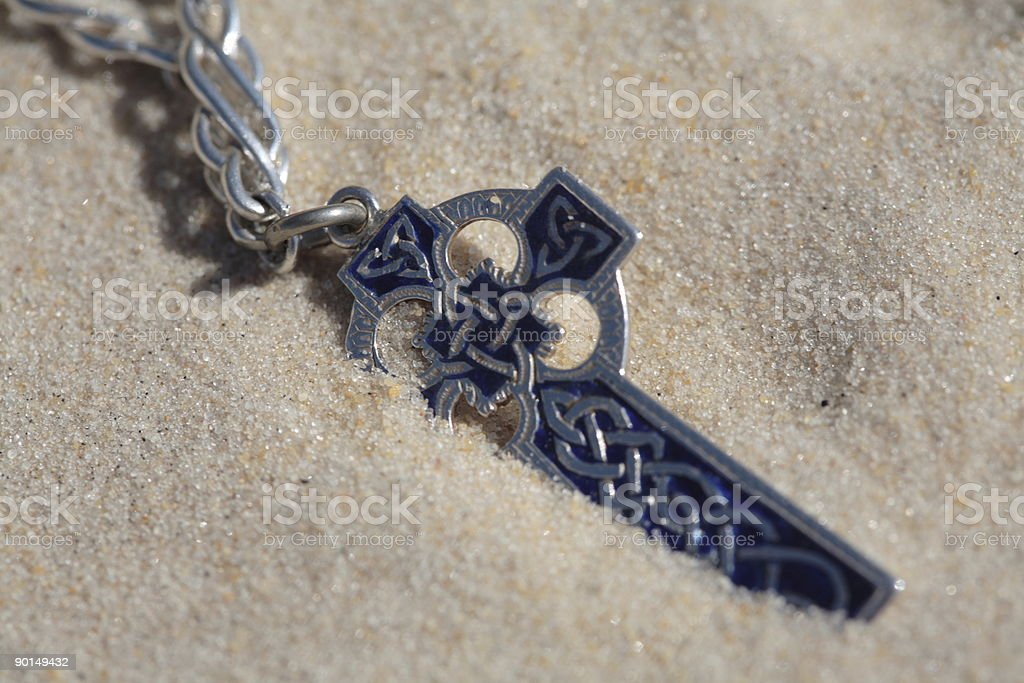 Cross and the Sand royalty-free stock photo