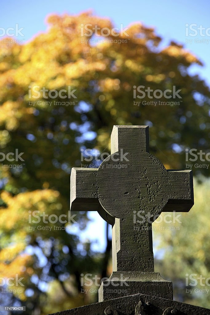 Cross and trees in autumn royalty-free stock photo