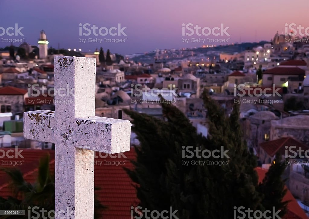 Cross and view on Old City of Jerusalem at sunset. stock photo