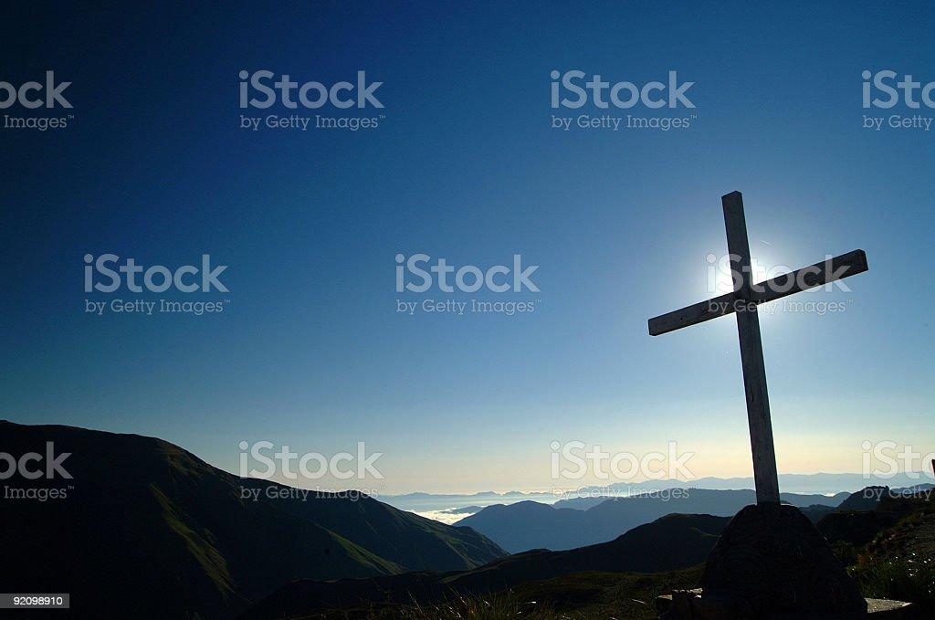 Cross at sunrise stock photo