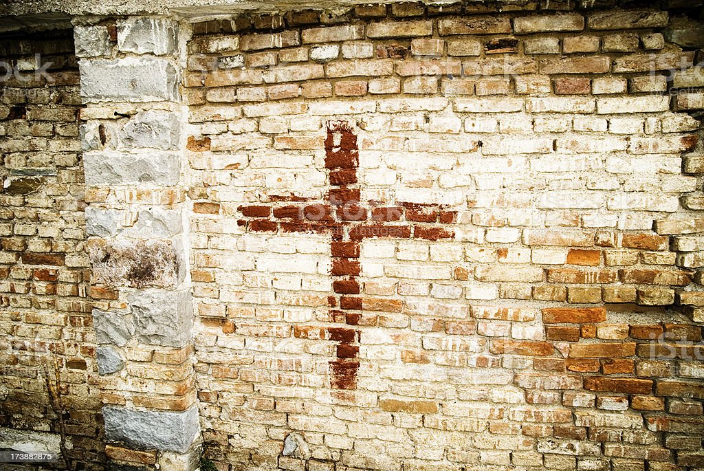 cross built into a brick wall royalty-free stock photo