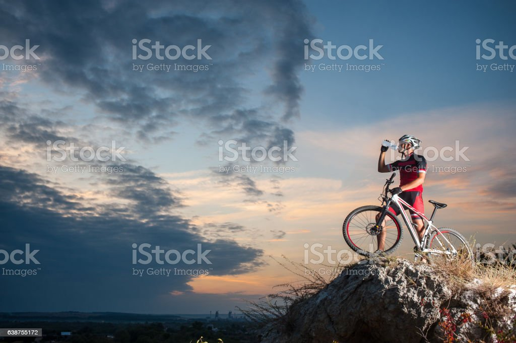 cross country biker relaxing on the top of the mountain stock photo