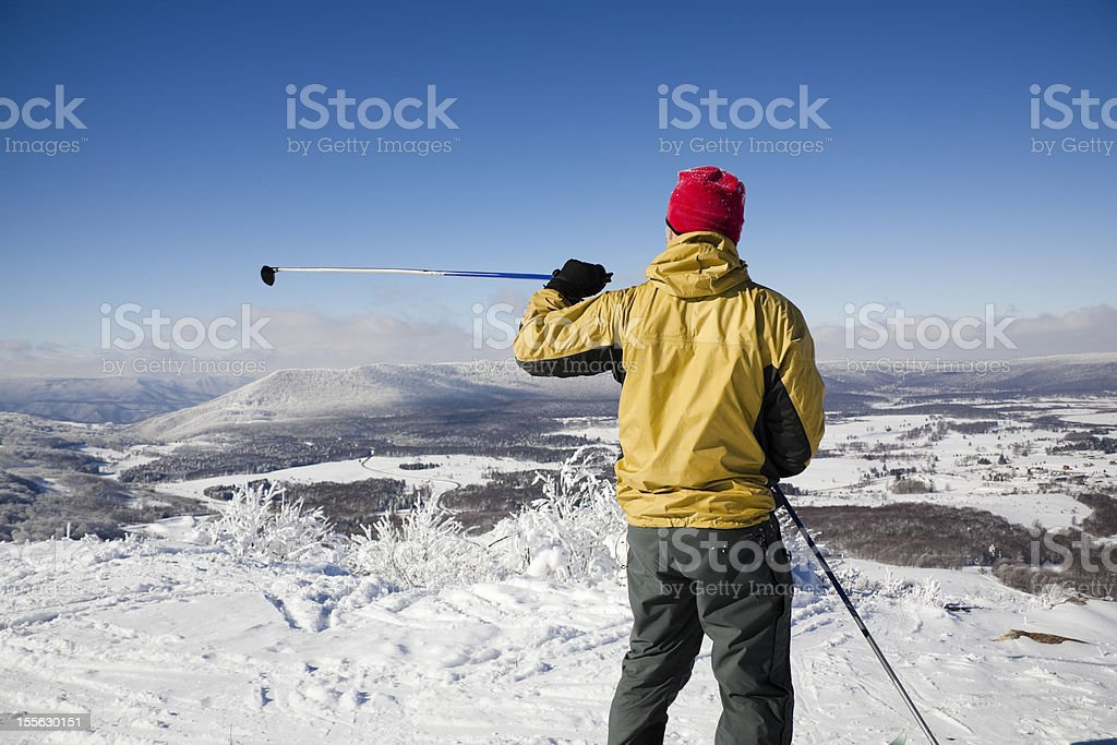 Cross country skier with a red hat royalty-free stock photo