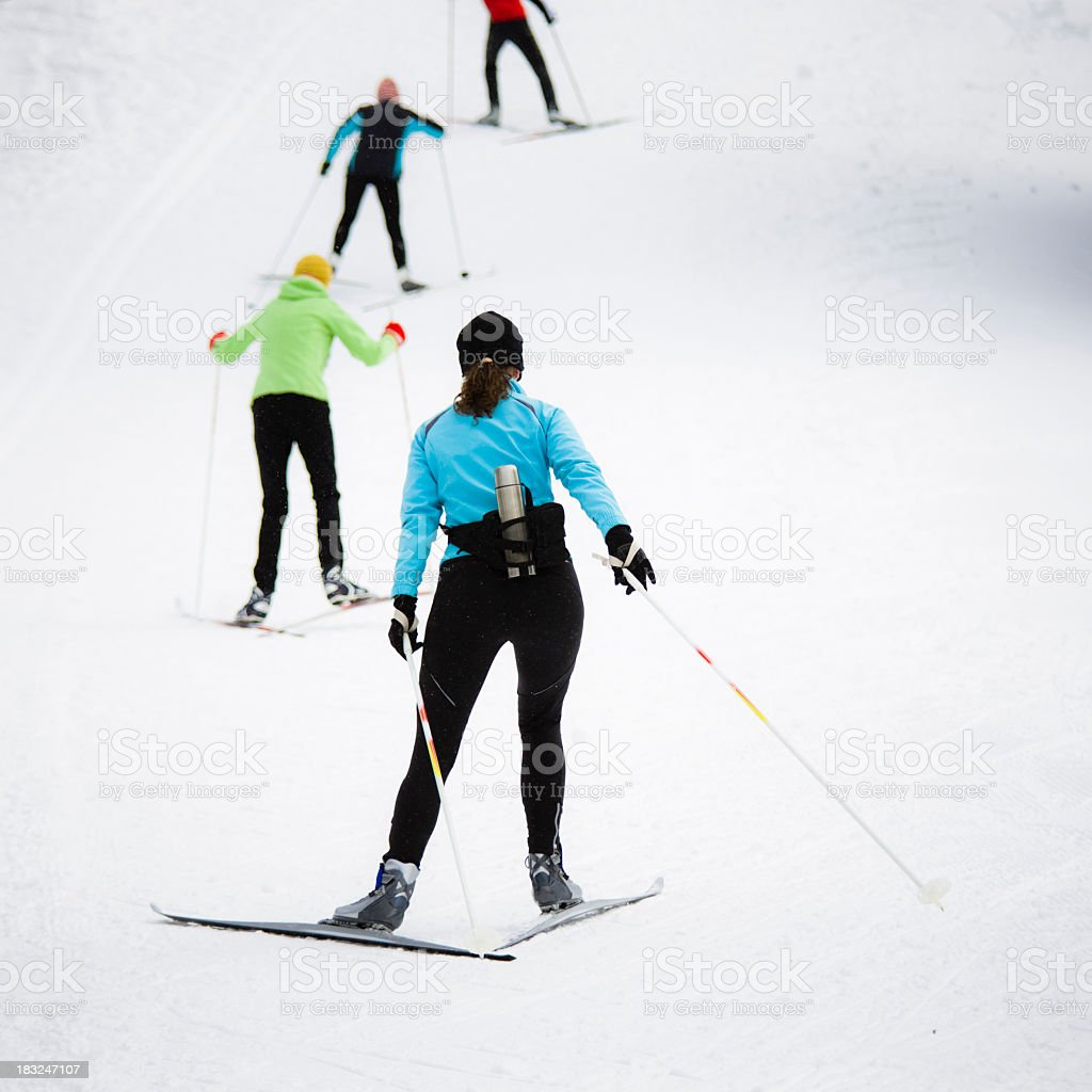 Cross country skiers moving across the plain stock photo
