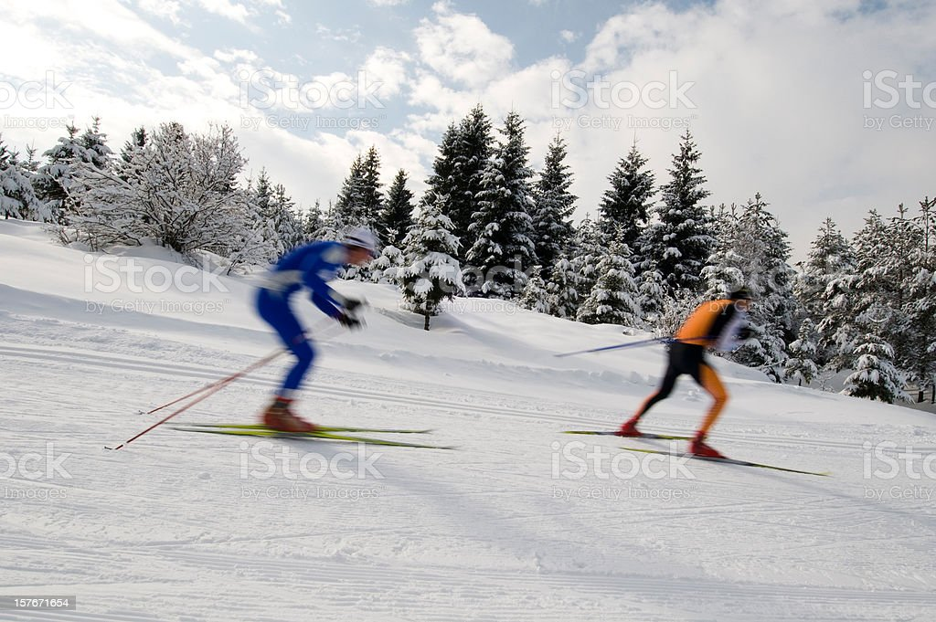 Cross country skiers practicing downhill stock photo