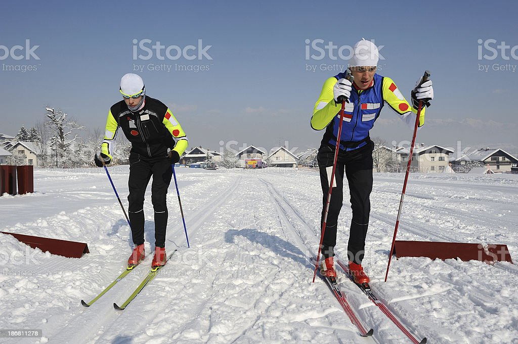 Cross country skiers practicing sprint royalty-free stock photo