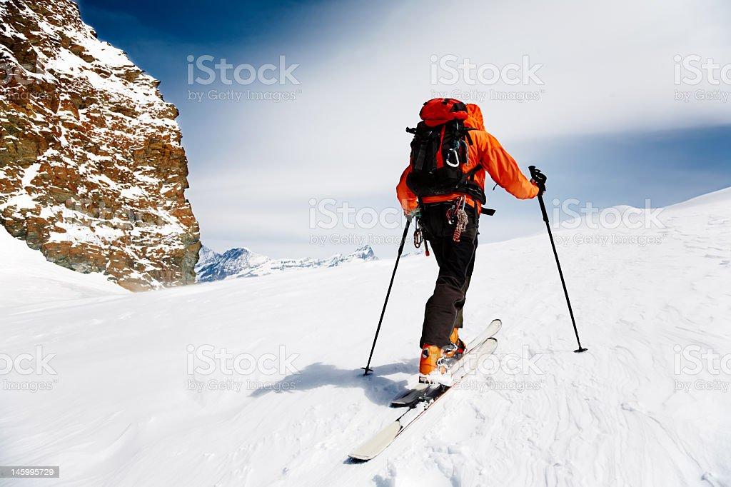 Cross country skiier with orange parka royalty-free stock photo