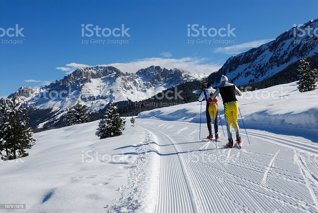 Two cross country skiers in beautiful winter landscape, Dolimites,...