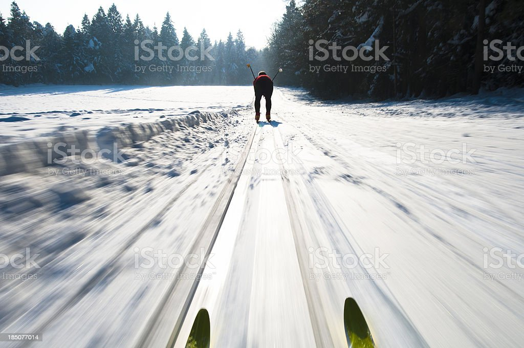 Front view of cross country skis during downhill at full speed -...