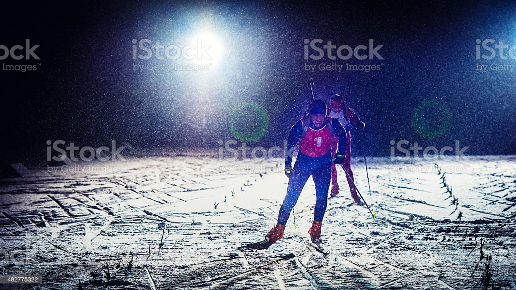 Cross country training at night stock photo