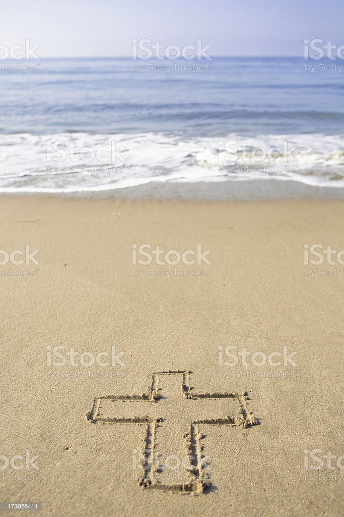 Cross Drawn in the Sand royalty-free stock photo