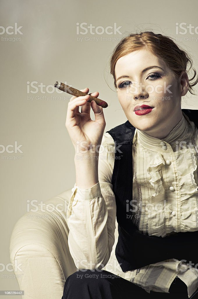 Cross dresser relaxing with a cigar royalty-free stock photo