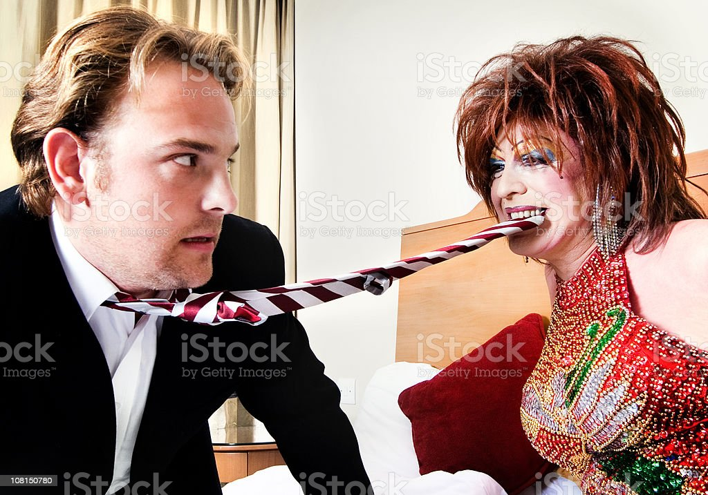 Cross Dressing Male Biting Businessman's Tie royalty-free stock photo