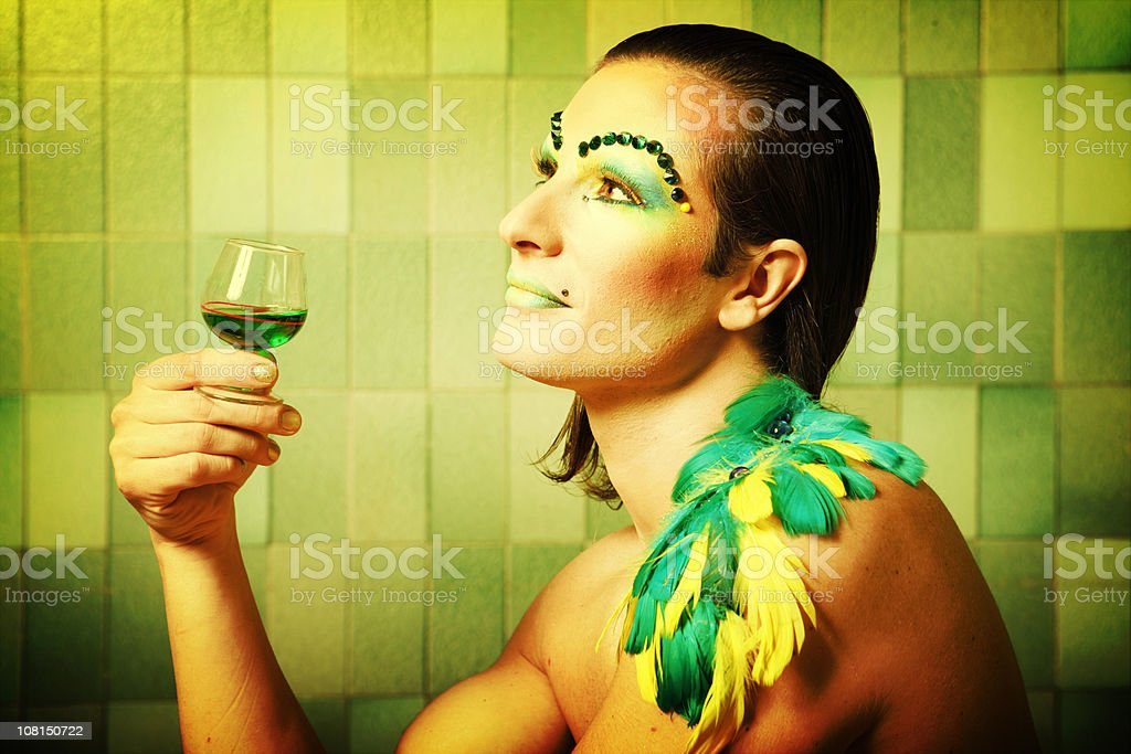 Cross Dressing Man Wearing Colorful Make-up and Feathers royalty-free stock photo