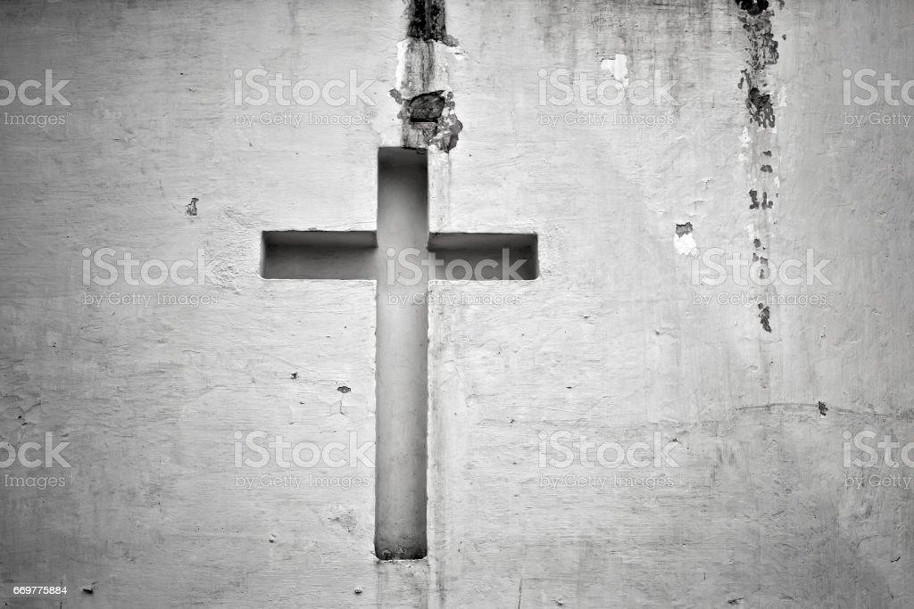 Cross figure religion wall stock photo