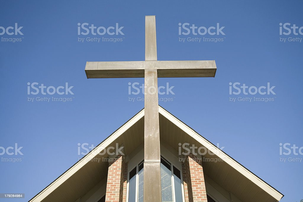 Cross in Front of Church Roof Blue Sky stock photo