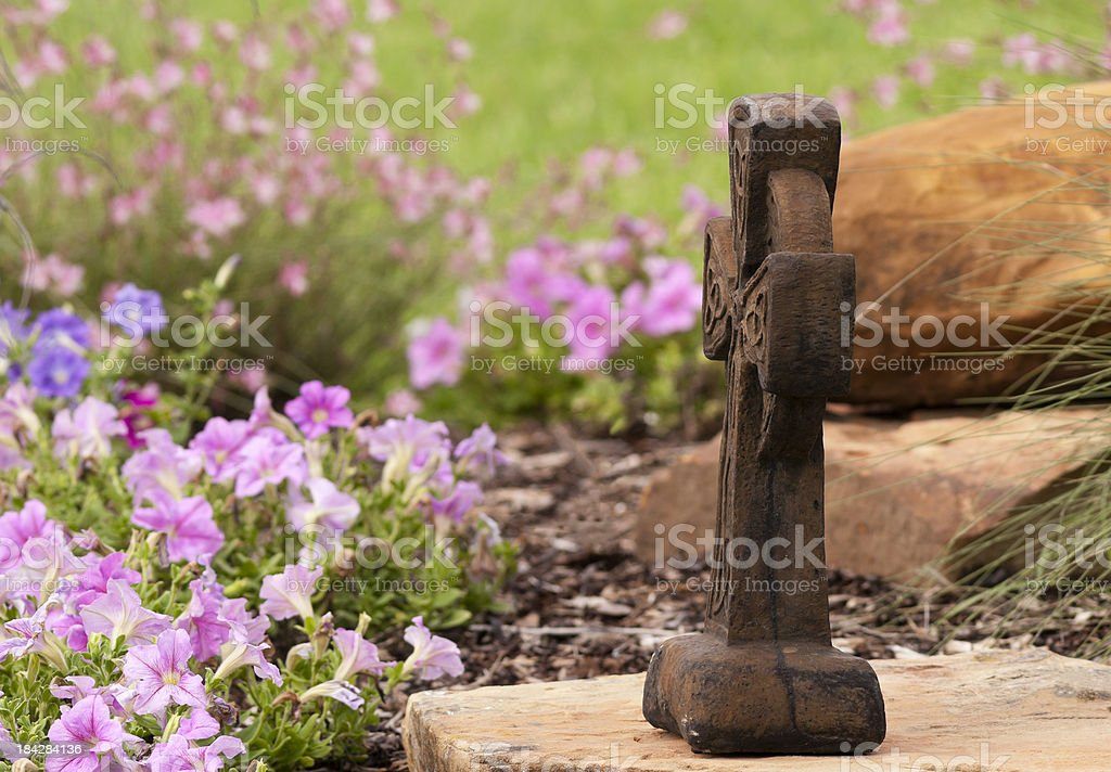 Cross in garden royalty-free stock photo