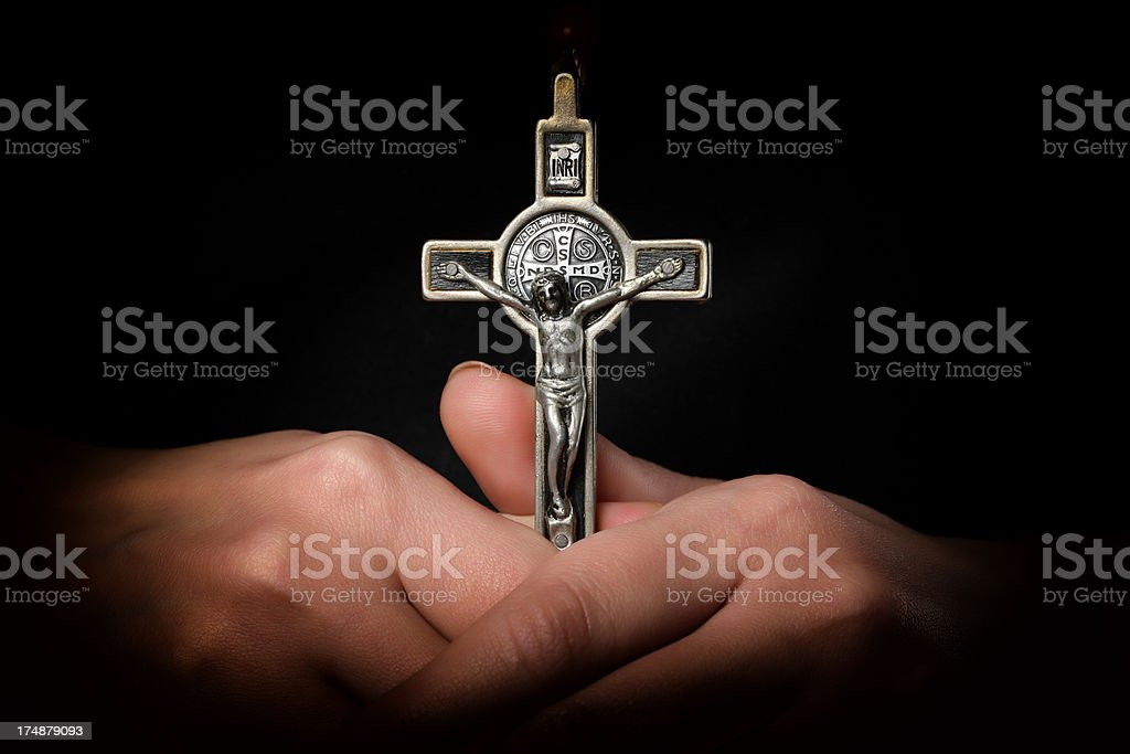 Cross in Hands stock photo