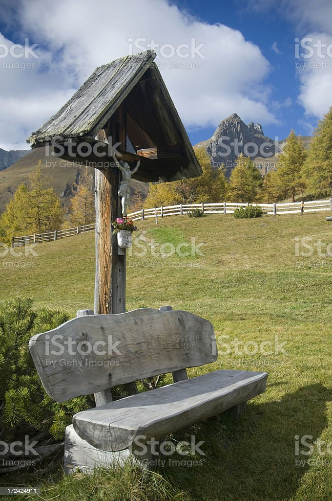 Cross in mountains stock photo