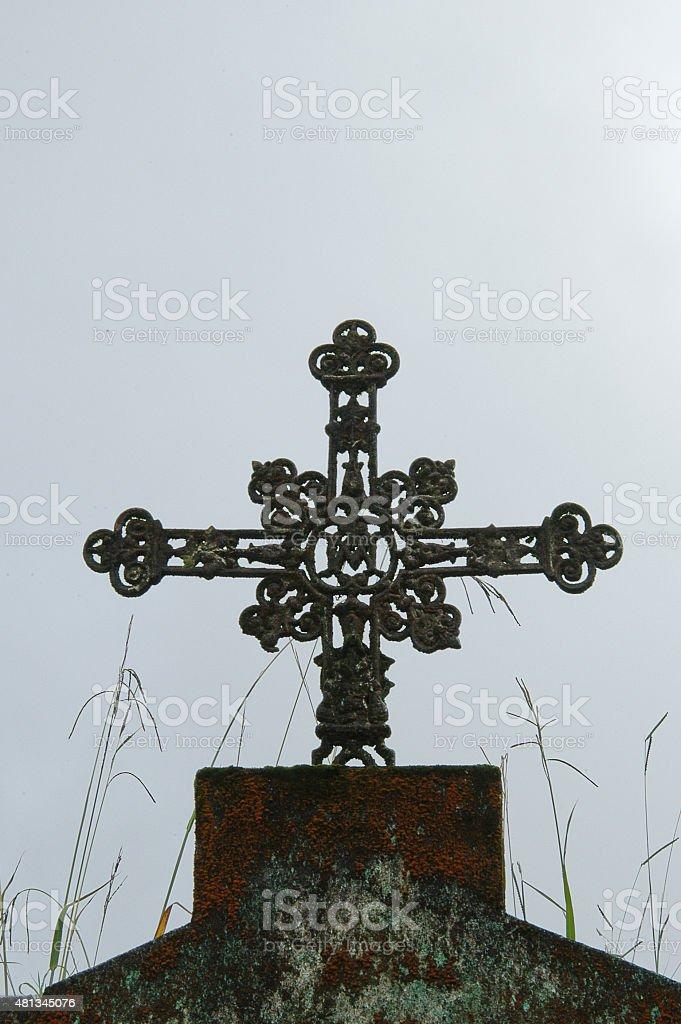 Cross in old grave stock photo