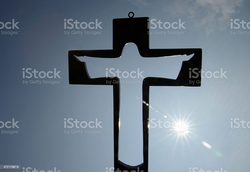 Cross in silhouette stock photo