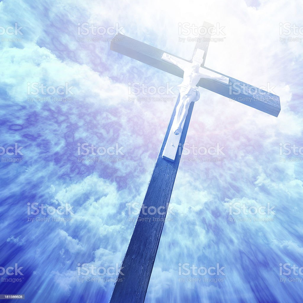 cross in sunrays against cloudy sky royalty-free stock photo