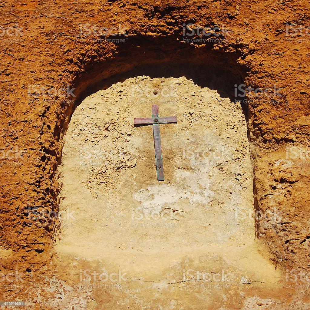 Cross in the arch. Wall of Castello di Lombardia. stock photo